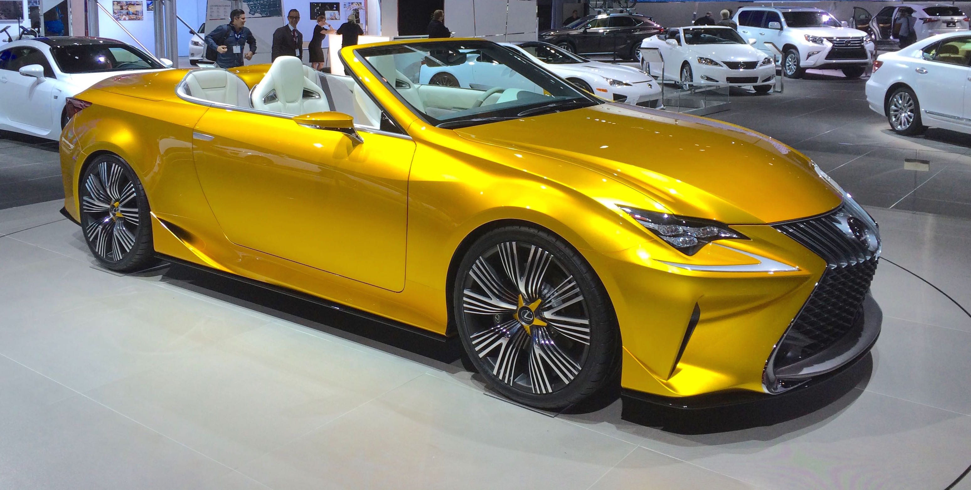The Roadster Looks Like A Sunflower Surrounded By Field Of White Lexus Production Models