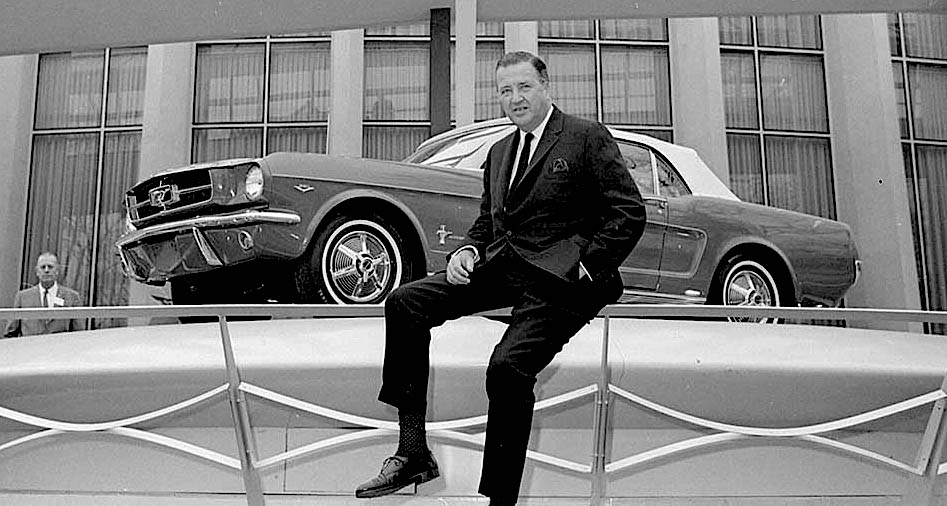 Henry Ford II poses with the all-new Mustang